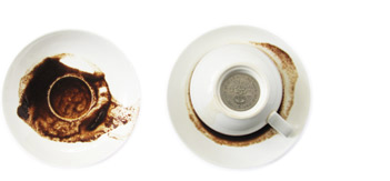 two coffee cups on little plates image